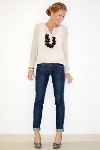 Dark jeans,  cream blouse,  back statement necklace