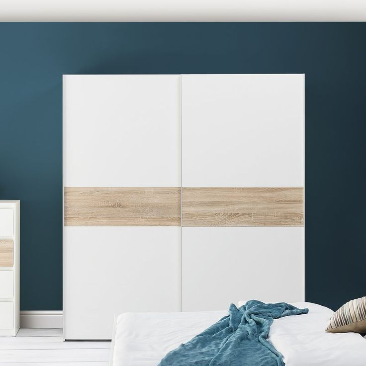 A modern bedroom, composed of minimalist shapes characterized by a simple form. A distinctive element of the furniture is the combination of white with sonoma oak decor. Lack of handles causes that the furniture gets an even more minimalist look. White perfectly matches other colours, so the collection will be perfect for many different interiors and designs.