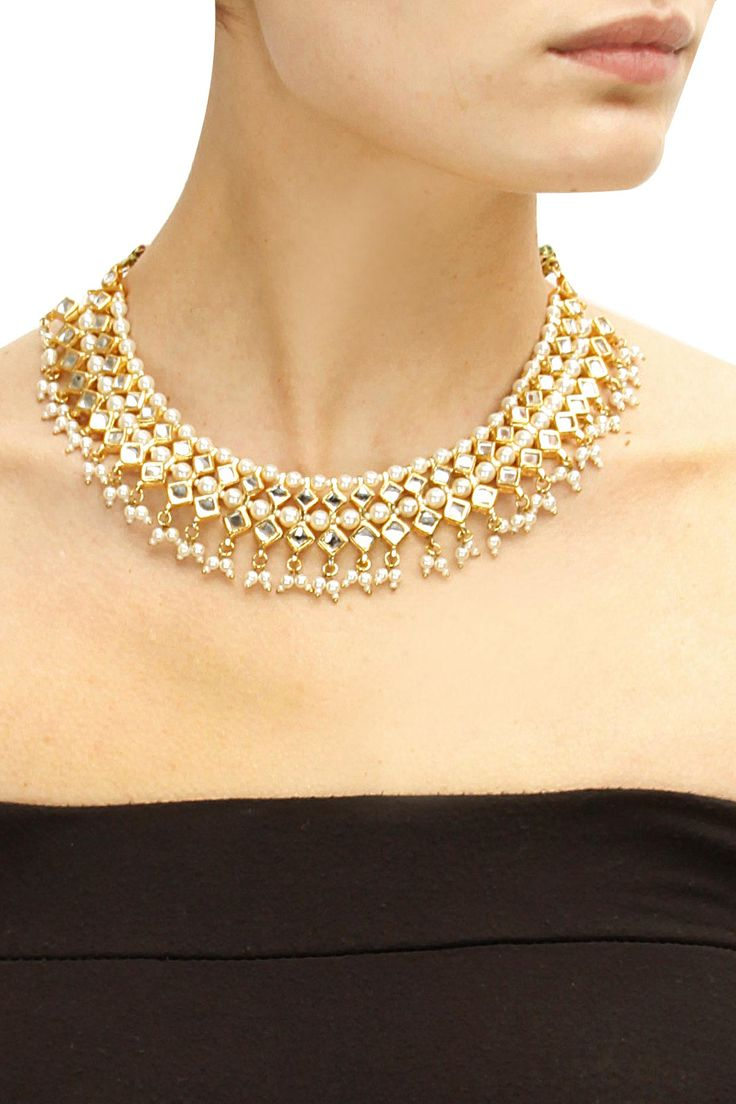 Gold plated pearls and kundan necklace by Soranam.
