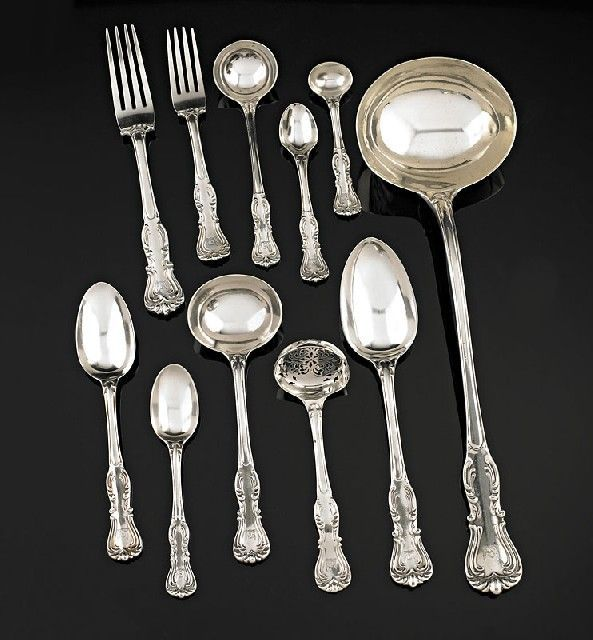 A Victorian silver Devonshire pattern flatware service, George w. Adams (Chawner & Co.), London, 1854, comprising eighteen table spoons, eighteen dessert spoons, seventeen tea spoons, six coffee spoons, four condiment spoons, three gravy ladles, five sauce ladles, twenty nine dinner forks, eighteen dessert forks, a large soup ladle and a sifter spoon, all engraved with an armorial cresting, (120), 9050gms (approx)