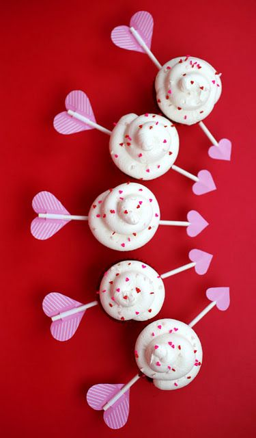 cupid's arrow cupcakes. just use a sucker stick and add hearts on either end (i'm thinking 2 heart stickers stuck to each other instead of taping a piece of paper on there)