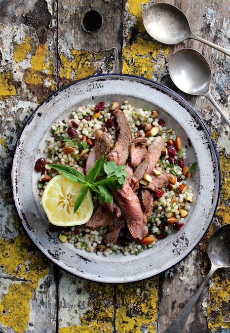 RAS EL HANOUT ROAST LAMB WITH JEWELLED COUSCOUS. Take a Persian inspired journey with Sami's Kitchen Ras El Hanout spice blend matched with South Suffork lamb. Served with pearl couscous tossed with cranberries, pistachios, almonds and fresh herbs.  30 Minutes. Packed with yumminess!