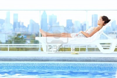 13281738-urban-luxury-city-lifestyle-woman-lying-by-pool-relaxing-in-sun-lounger-during-summer-in-montreal-qu.jpg 400×267 pixels