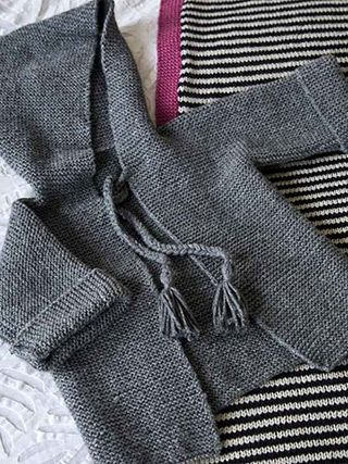 Appley Hoodie from Easy Knits for Babies Martin Storey's collection of 14 projects of easy knits for babies from birth to eighteen months includes simple cardigans, cosy hoodies and a cool striped blanket perfect for the buggy or nursery | English Yarns