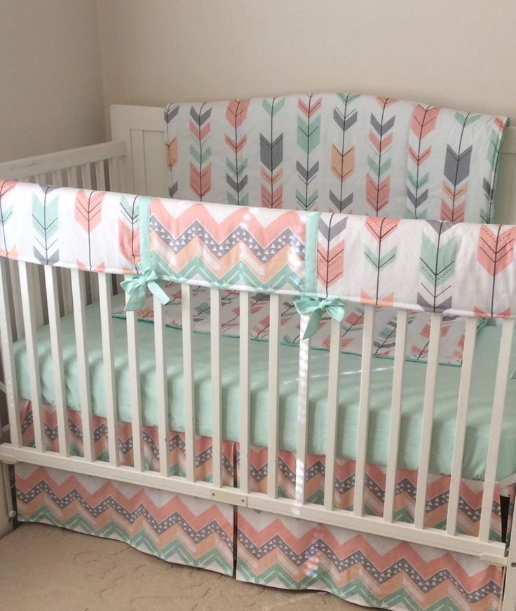 Coral peach pint and gray arrows crib bedding  A personal favorite from my Etsy shop https://www.etsy.com/listing/265521964/peach-gray-and-mint-arrows-and-deer-crib