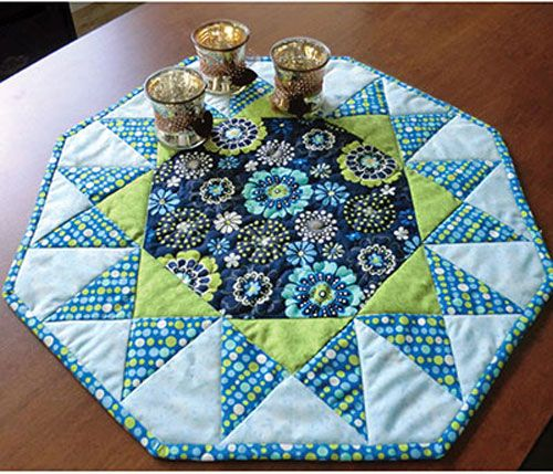 Quilt a burst of color for your kitchen! This fabulous table topper pattern is great for quickly and easily giving your kitchen a pop of color! The octagon