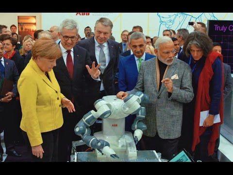 Hannover Messe 2015: Bundeskanzlerin Angela Merkel mit Zweiarm-Roboter - YouTube