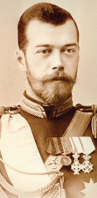Tsar Nicholas II. Maybe it's his mustache that makes him look like he's smiling. Haha