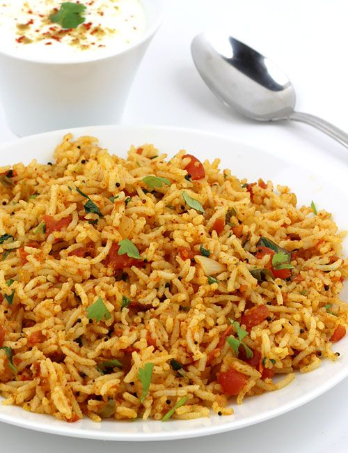 Tomato Rice - Plain Steamed Rice Cooked with Tangy-Spicy Mixture of Sautéed Tomato, Onion, Coriander leaves and Indian spices. This Step by Step Photo Recipe Includes Instructions for Both North Indian Tomato Rice (Pulao) and South Indian Tomato Bath Preparations and Guides You Where Things Differ.