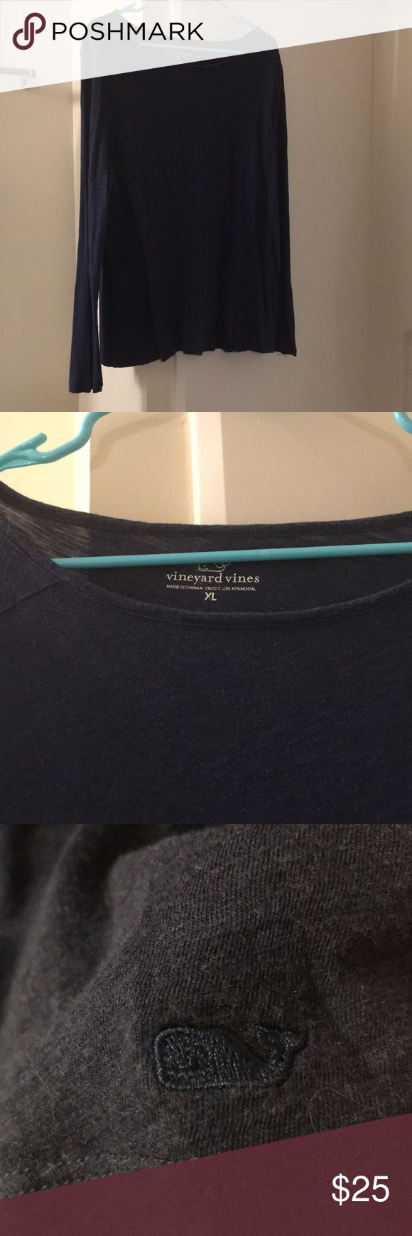 """Vineyard Vines women boatneck casual top Gently Used Condition. Great neutral navy color. Flattering boatneck top and relaxed fit. 60%cotton/40%modal.  underarm to underarm= approx. 20"""" Shoulder to bottom hem= approx. 27"""" Pet friendly home but stored in a closed closet. Vineyard Vines Tops Tees - Long Sleeve"""