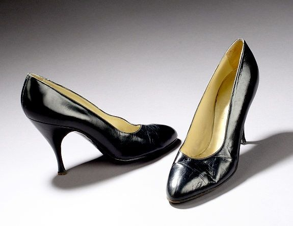 Marilyn Monroe's black leather high-heeled pumps were first sold by Christie's in 1999. Inside the shoe, the label reads 'Creazioni Dal Co.,' alongside the number, '38hl'.