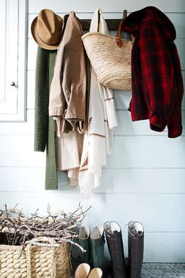 How to re-do the entry so there is a place to change shoes, hang clothes, store bags? One solution from Rita Konig.