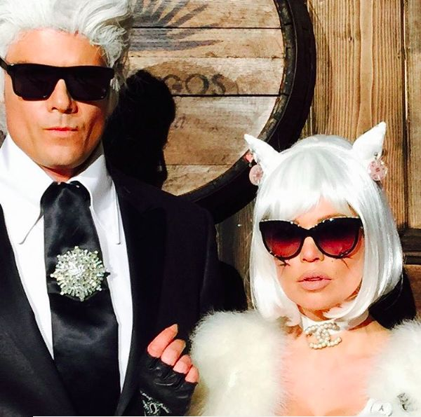 """The pop-culture costume is always a risky decision, but we have to give a round of applause to Fergie and Josh Duhamel's rendition of """"Karl and Choupette."""" If you're going to be a cat on Halloween, might as well be the most pampered feline in the world, right? #refinery29 http://www.refinery29.com/2015/10/96704/best-celebrity-halloween-costumes-2015#slide-25"""