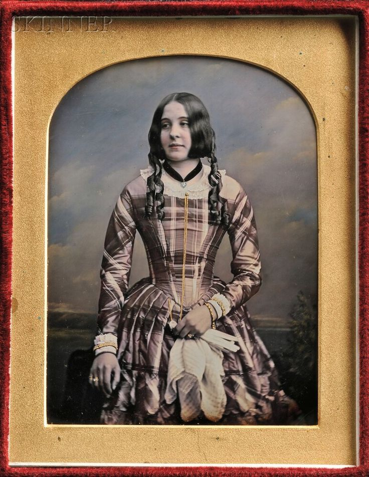 "William Edward Kilburn (British, 1818-1891). Hand-tinted Quarter-plate Daguerreotype of a Young Woman, in a leather case stamped ""BY APPOINTMENT MR. KILBURN 234 REGENT STREET"" in gold.  (Continued in comments.)"