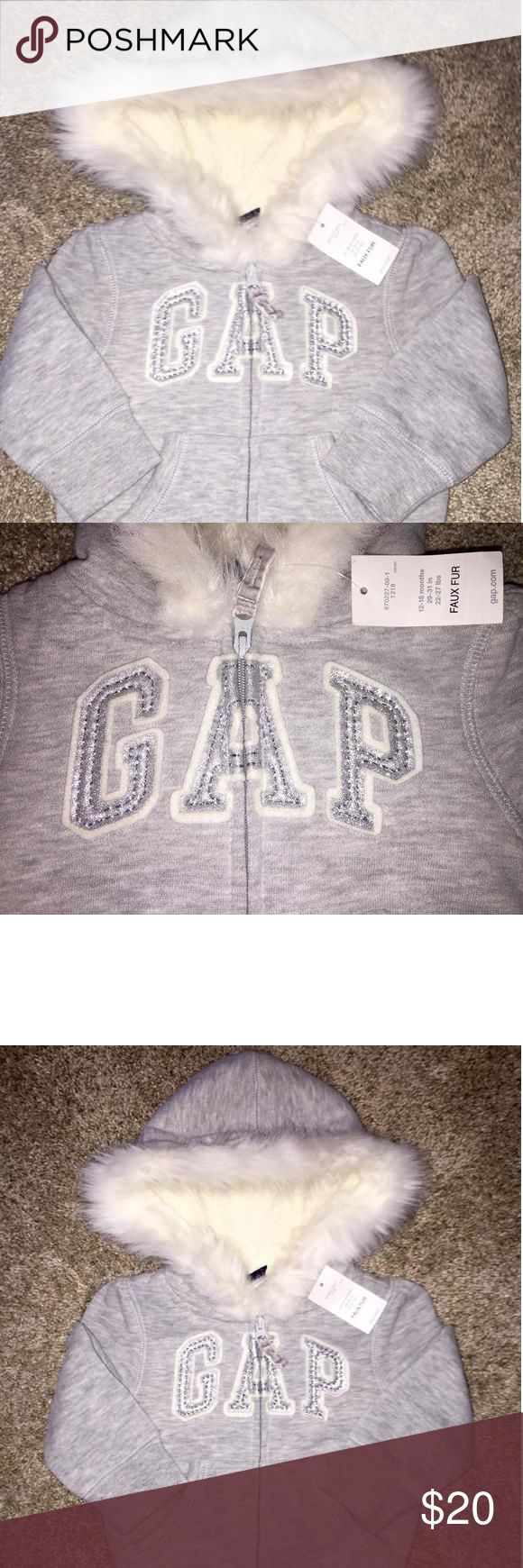 Baby GAP Faux Fur Hoodie with Glitter Logo 12-18 months GAP Faux Fur Hoodie with Glitter Logo with Faux Fur inside the body of hoodie and on hood. Super Cute & warm perfect for Fall GAP size 12-18 months Baby Gap Shirts & Tops Sweatshirts & Hoodies