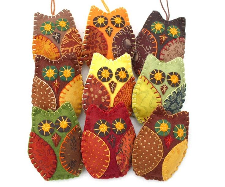 Three owl ornaments in autumn, fall colors, handmade from felt and cotton prints with hand embroidered details. Each owl is 8cm high and has a cotton loop for h