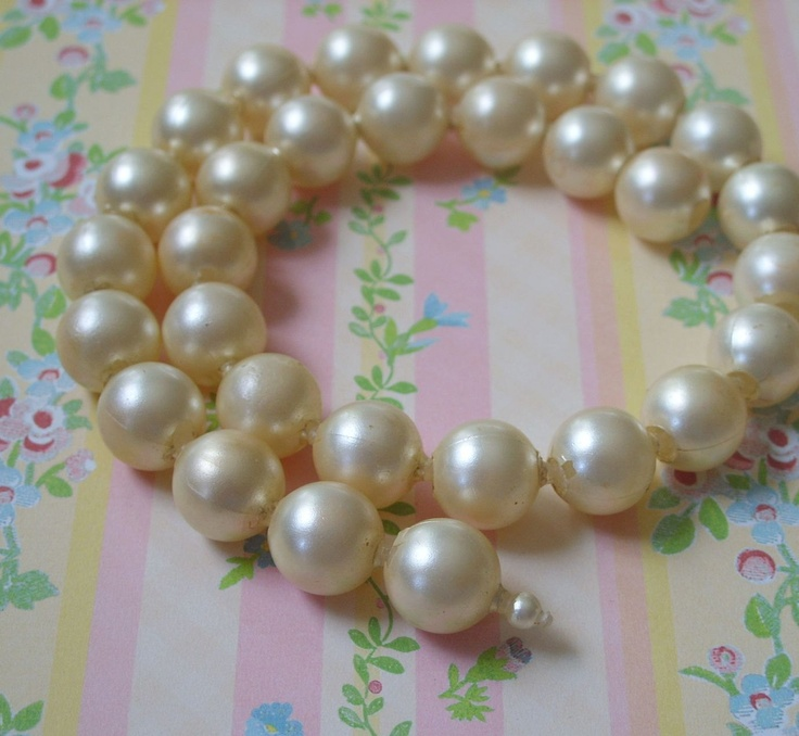 Anyone remember these?  Vintage White Faux Pearl Pop Beads Necklace 1950s or 60s. $3.50, via Etsy.