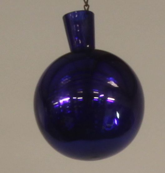 "Lot 236, A 19th Century bottle shaped ""Bristol"" blue glass witches ball 7"", est £40-60"