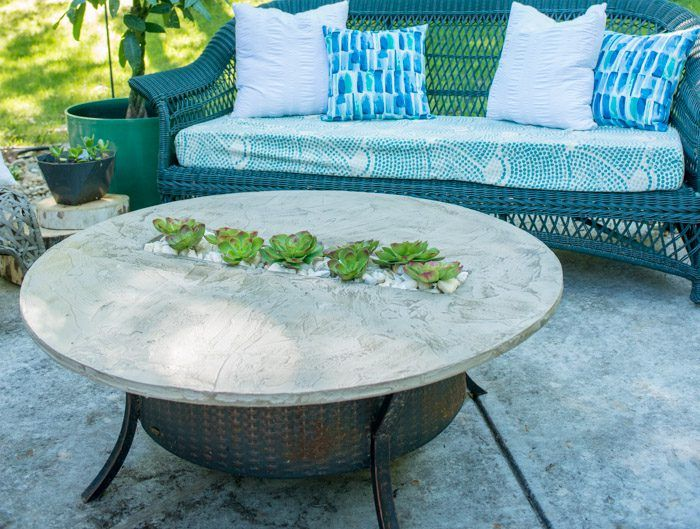 Get rid of the ugly tarp covering your fire pit and make this chic fire pit topper with a river rock garden insert.