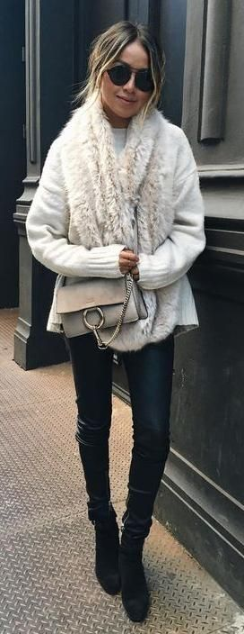 waxed jeans. knit cardigan. fluffy scarf. street style.