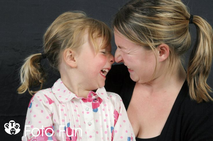 Mum and daughter face to face laughing hard