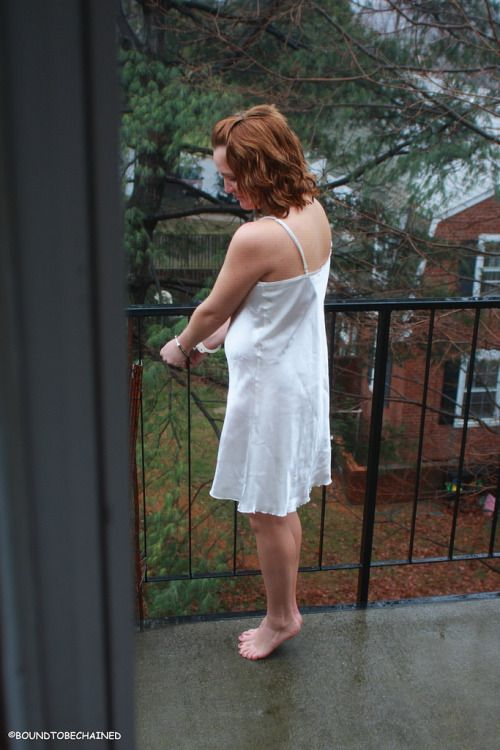Woman In Nightgown Handcuffed On The Balcony Chilling In A