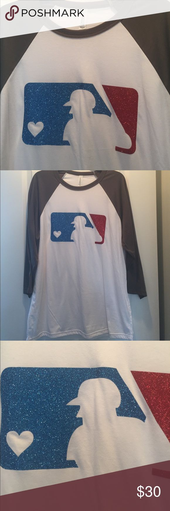 Custom glitter baseball tee with ❤️️ fits 14/16 I ordered this custom, it came in beautiful-exactly what I wanted, so soft and comfy & adorable, however it's much too large for me. I can't return it. I'm ordering another in a smaller size as soon as I sell this. I wear between a 12 and a 14 and this would definitely fit a 14 and 16. Very loose fit soft three-quarter sleeves the T-shirt is excellent quality and the screen is a beautiful sturdy glitter with the heart cut out of the…