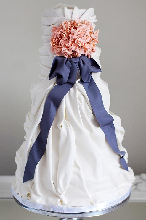 Sophie Bifield's mastery of fondant and gum paste is evident in the lifelike pleats and folds of this wedding cake.