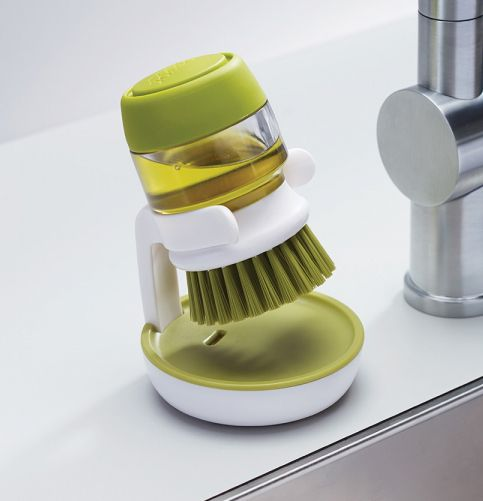 Palm Scrub design by Joseph Joseph. This sturdy palm-held washing-up brush features an easy-fill washing-up liquid reservoir that dispenses the required amount of soap with a simple push of the top button. Its compact size makes it easy to control and ideal for cleaning pots, pans and dishes. http://www.zocko.com/z/JJyx1
