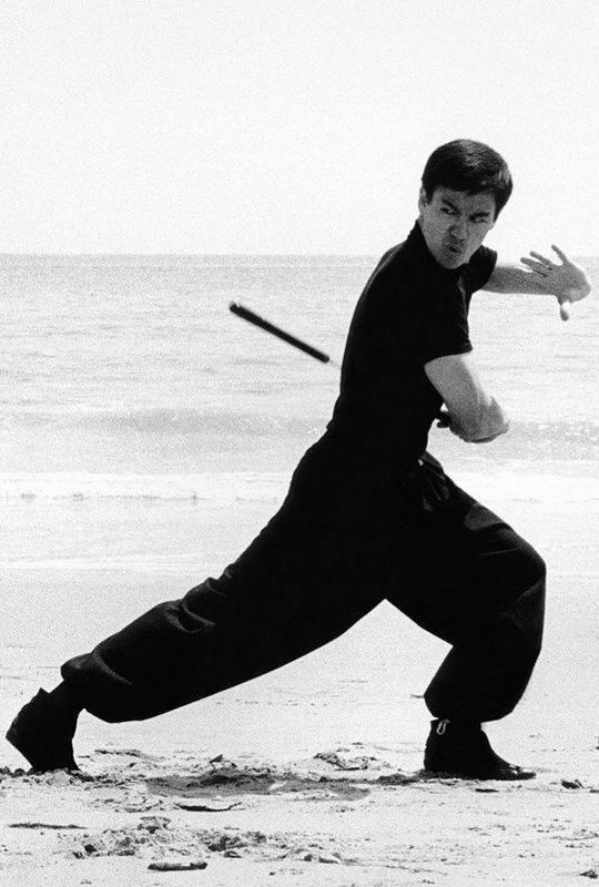 Bruce Lee training on the beach, 1960s                                                                                                                                                                                 More