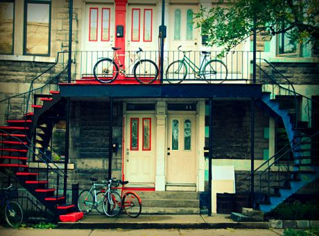 "Doesn't everybody dream of ""His and Hers"" apartments? This is another example of Montreal's ""Plateau"" neighborhood, with it's is colorful homes and cast iron staircases."
