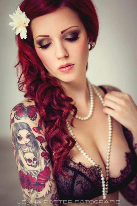 Love the hair color and tattoos