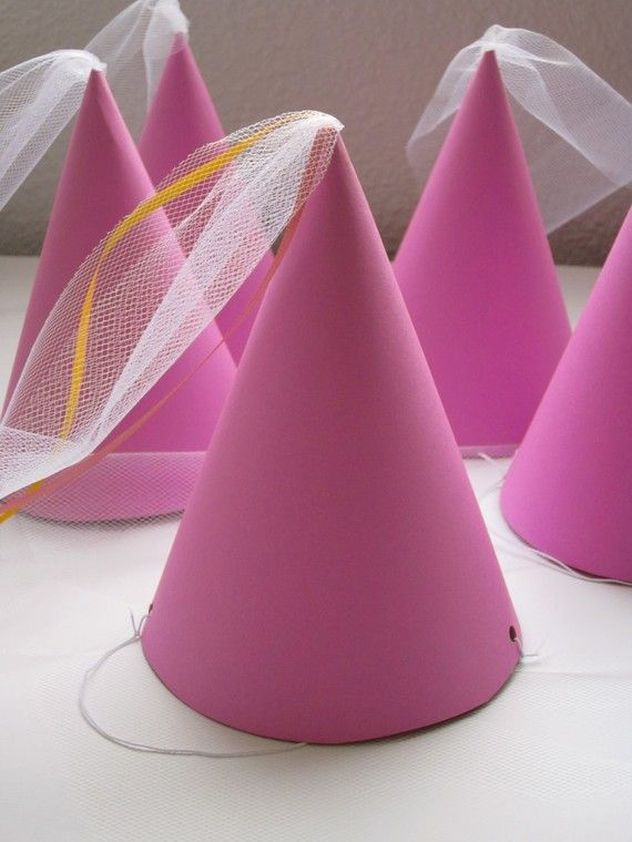 Princess Party Hats. Make with Pink Cardstock and Tulle. Punch holes and add elastic. Use assorted Press On Jewels and foamies to decorate.