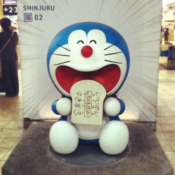 "loosersugar:  #doraemon #japan #shinjuku station (at 新宿駅 (Shinjuku Sta.))  Doraemon is eating 「テストにアンキパン」or ""memorizing toast"". Wouldn't it be great never having to study for a test again?"