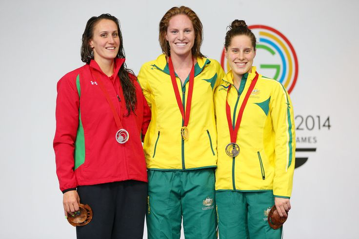 Gold medallist Emily Seebohm of Australia poses with silver medallist Georgia Davies of Wales and bronze medallist Belinda Hocking of Australia
