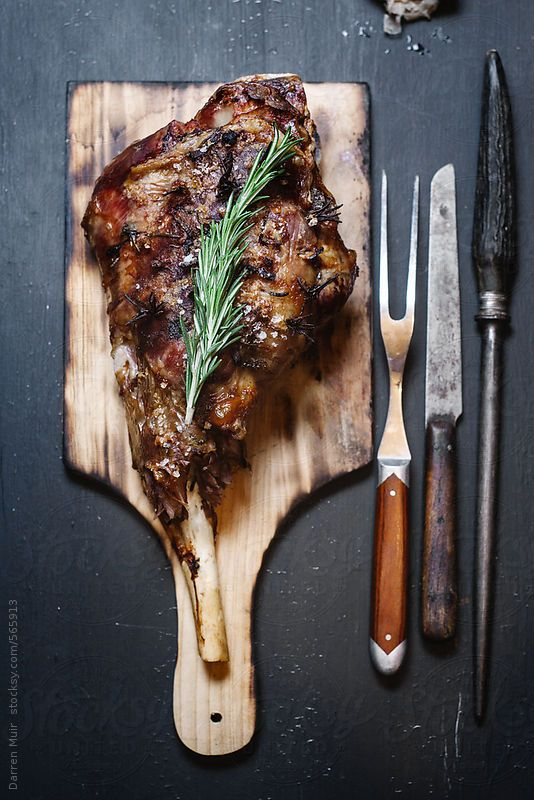 Roast leg of lamb. by Darren MuirAvailable to licence on stocksy. Quote DARRENMUIR20 on checkout for 20% discount. #food #photography #lamb #spring #easter #stocksy #stock #discount #code