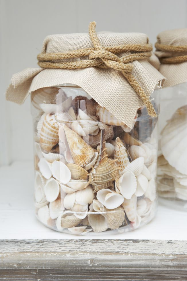 Great idea with jars and some fabric. Go for this rustic look or something a little cleaner even!