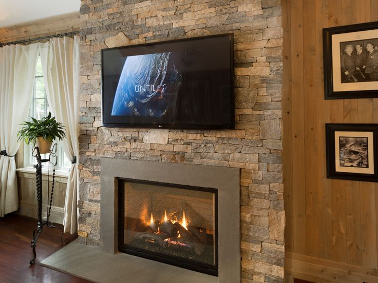 European style home with natural thin stacked stone for European home fireplace