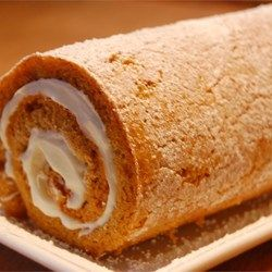 Pumpkin Roll Cake Recipe and Video - A thin pumpkin cake, rolled around in a white cream filling, then in nuts. Can be frozen and served chilled. Dust with confectioners' sugar, if desired.