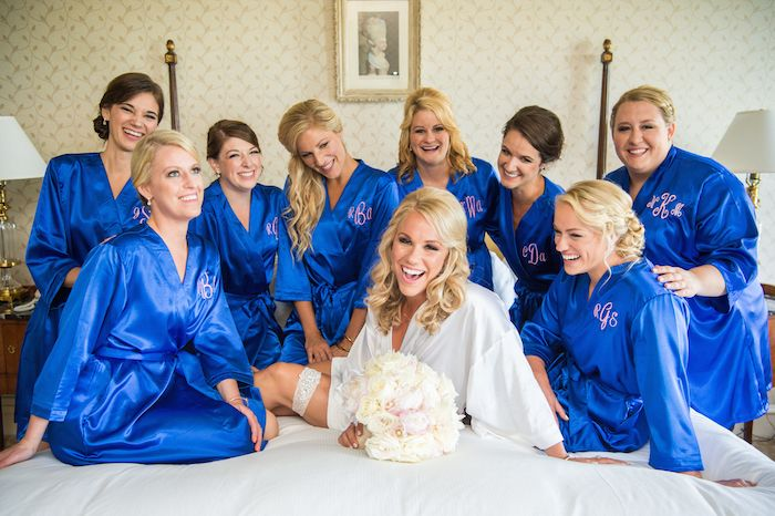 Blue Getting-Ready Bridesmaid Robes | Photo: Carasco Photography. View More: https://www.insideweddings.com/weddings/catholic-ceremony-classic-chicago-reception-with-a-hint-of-bling/897/