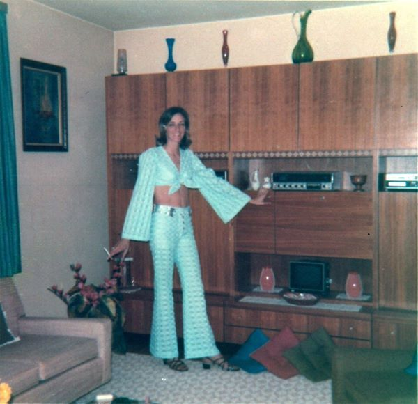 And here is Trudy, demonstrating once again her mastery of accent pillows. Unfortunately, this flair did not extend to her taste in fashion. What was she thinking when she chose those sandals?