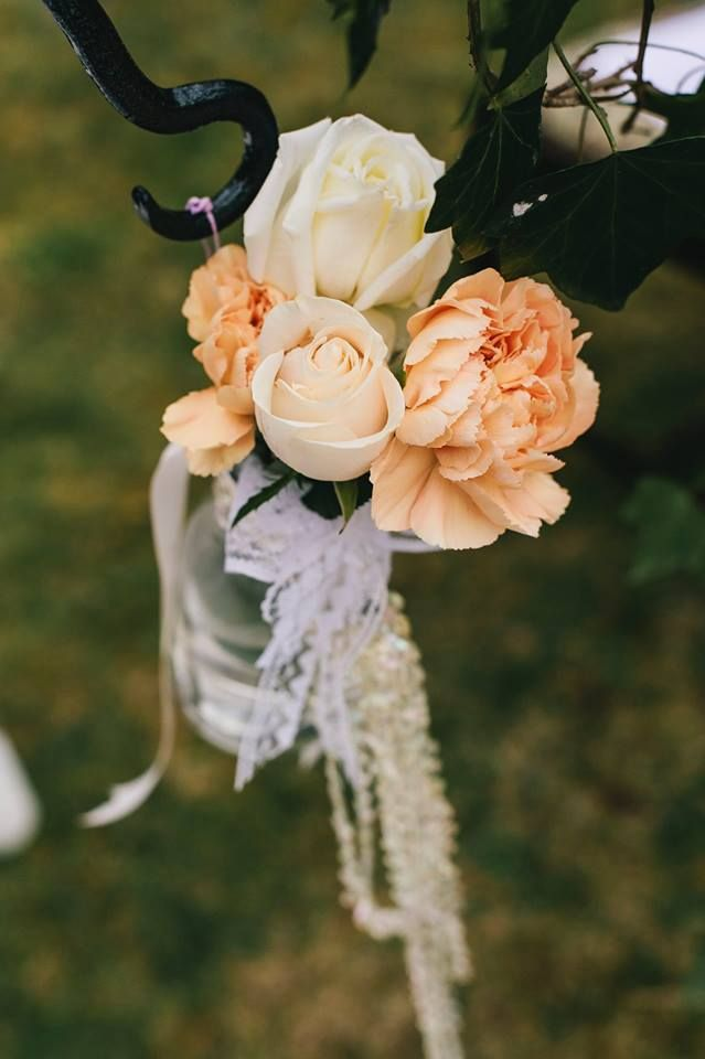 Peach and cream flowers hanging in bottles with lace and crystals - Oh Happy Day!