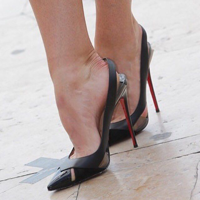 Black slingback pumps and toe cleavage