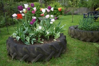 Recycle old tyres into a beautiful Garden Planter. Paint them and fill with your favourite plants.