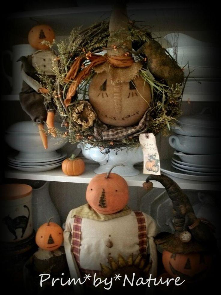 A Scarecrow Wreath and Pumpkin doll primitive autumn gathering