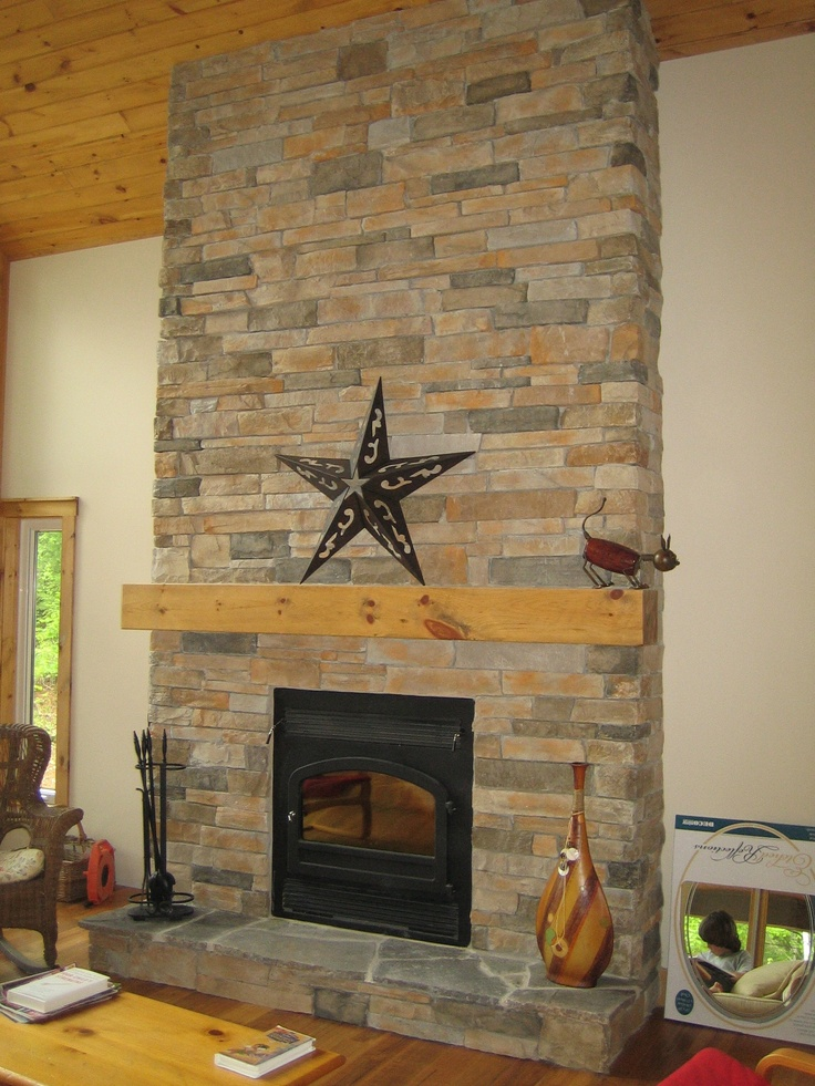 Fireplace veneered with Cultured Stone Aspen Country Ledgestone and natural Hearth Stones.