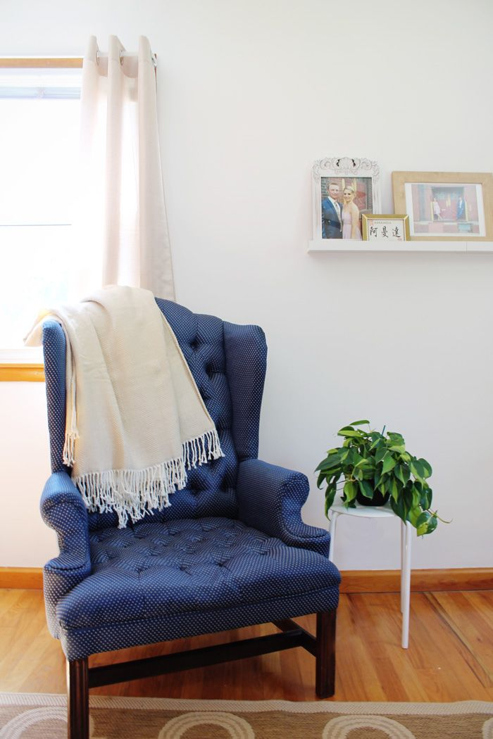 Our Office Makeover | blue tufted chair, industrial bookcase, jute rug and parsons desk