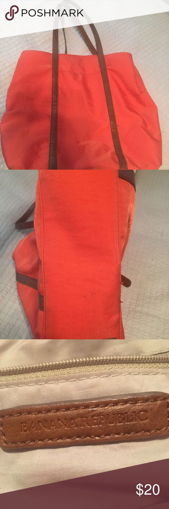 """Banana Republic tote - Red Adorable Red tote bag by Banana Republic.  """"Blake"""" style bag, red nylon with brown leather handles and trim.  Bag details: 3 compartments, button snap and center zipper.  H - 15"""" W - 16"""" D - 6"""" Excellent used condition Banana Republic Bags Totes"""
