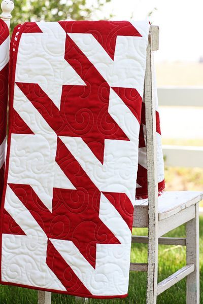 <3 Houndstooth!!!  The red and white would look cute at Christmas at the foot of a bed.