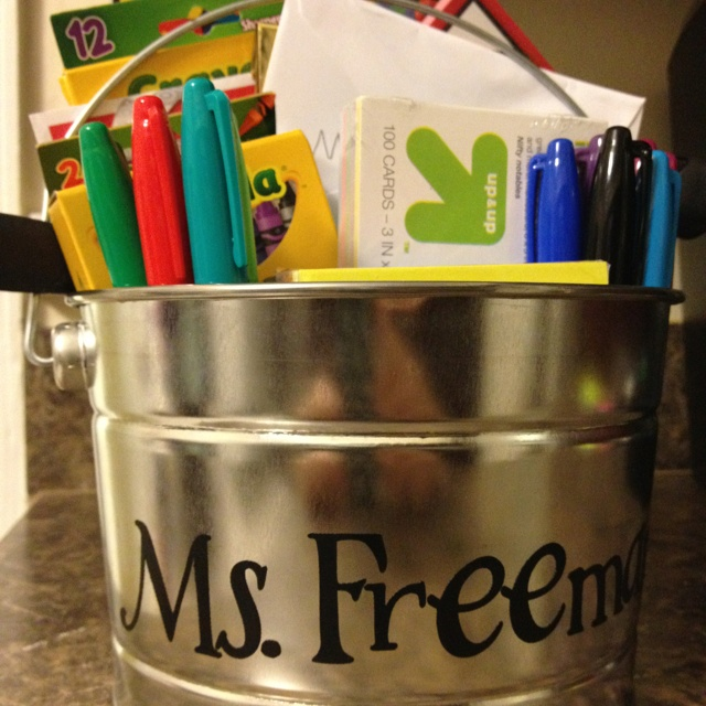 """Teacher bribe, I mean gift... For 1st grade. I got a $3 bin at home depot, put in chocolate, reward stickers, teacher to-do notes from the Target $1 bin, crayons, note cards, post-its, colored pencils, sharpee markers, a gift card and a personal note from my daughter. We are planning to take it to """"meet the teacher day"""" tomorrow!"""